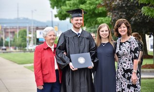 family with male graduate at Commencement