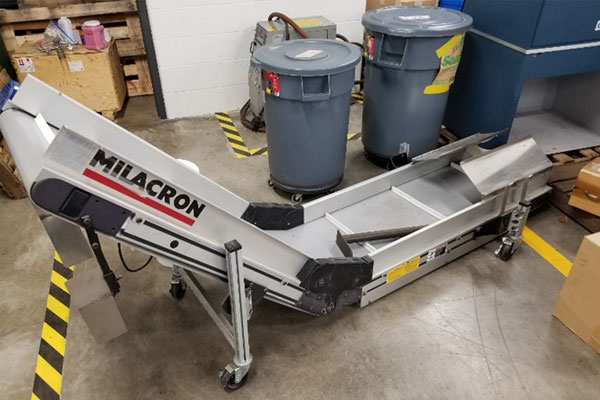 Milacron take away conveyor