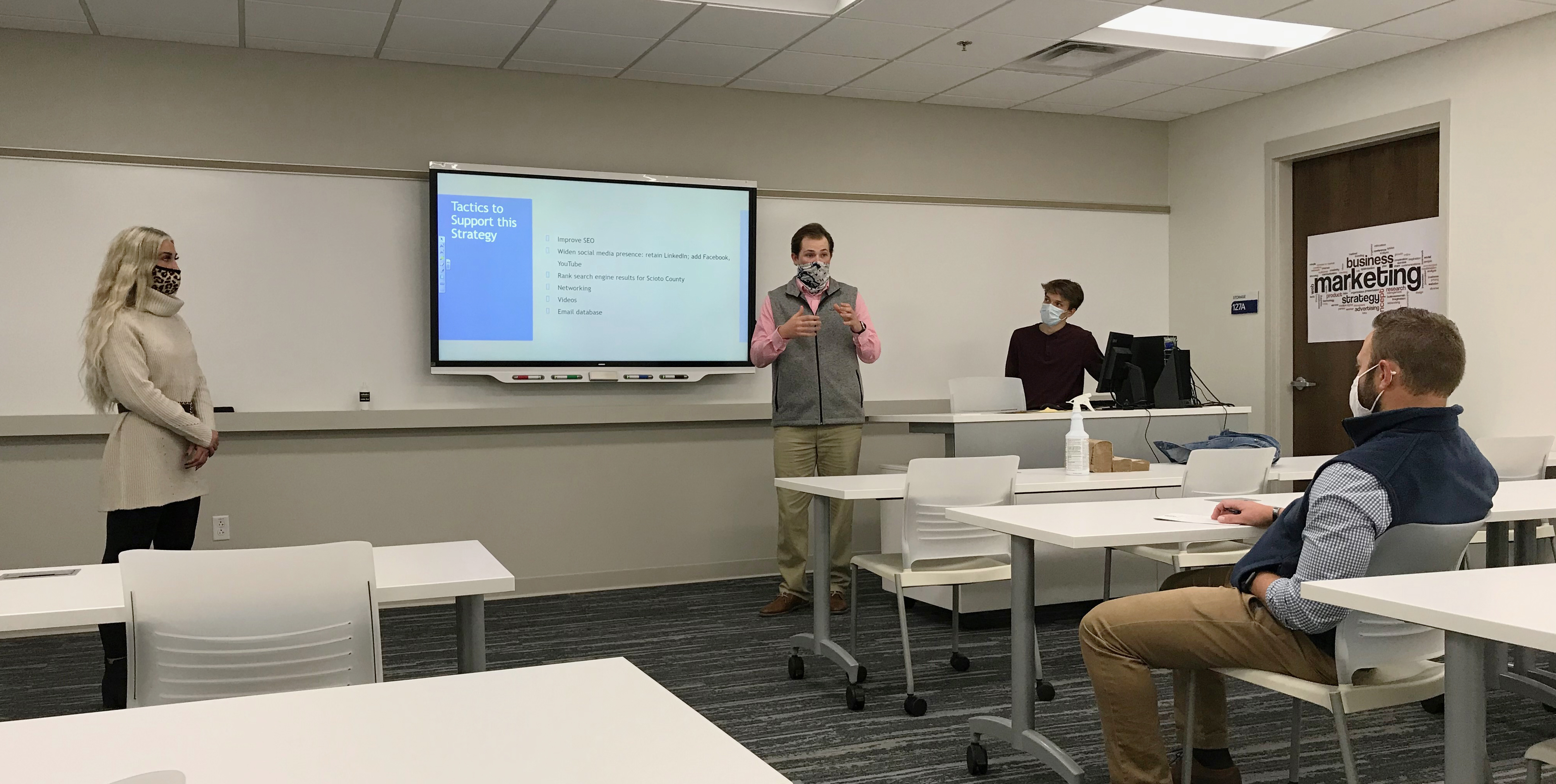 Marketing majors Madison Campbell, Drew Lowe and Owen Reeher present a proposal to local client Matt Setters, CEO of Setters CPA & Co.