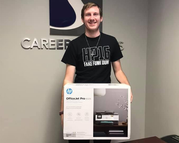 Ian Polcyn posing with a printer