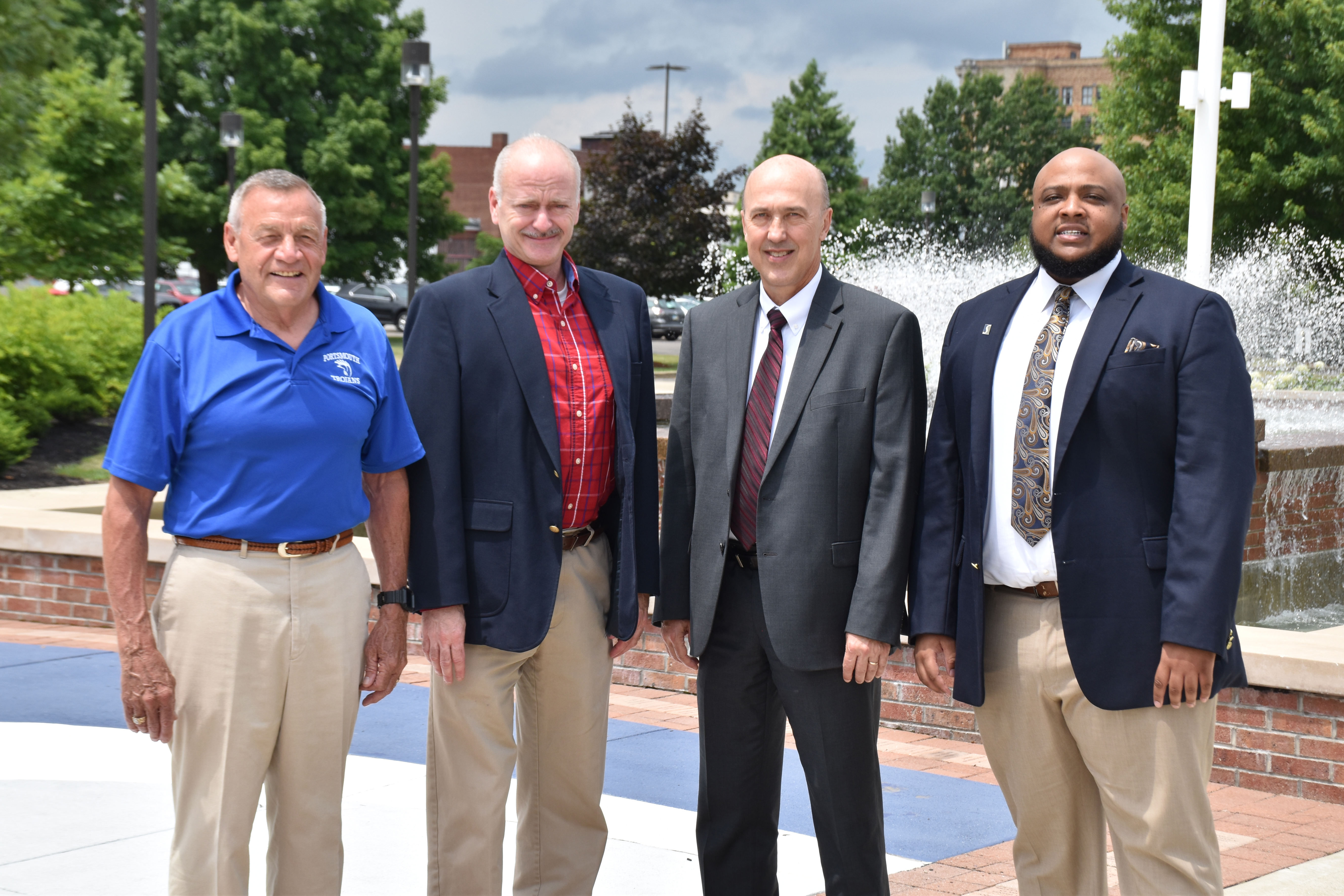 Four men representing leadership at Portsmouth High School and Shawnee