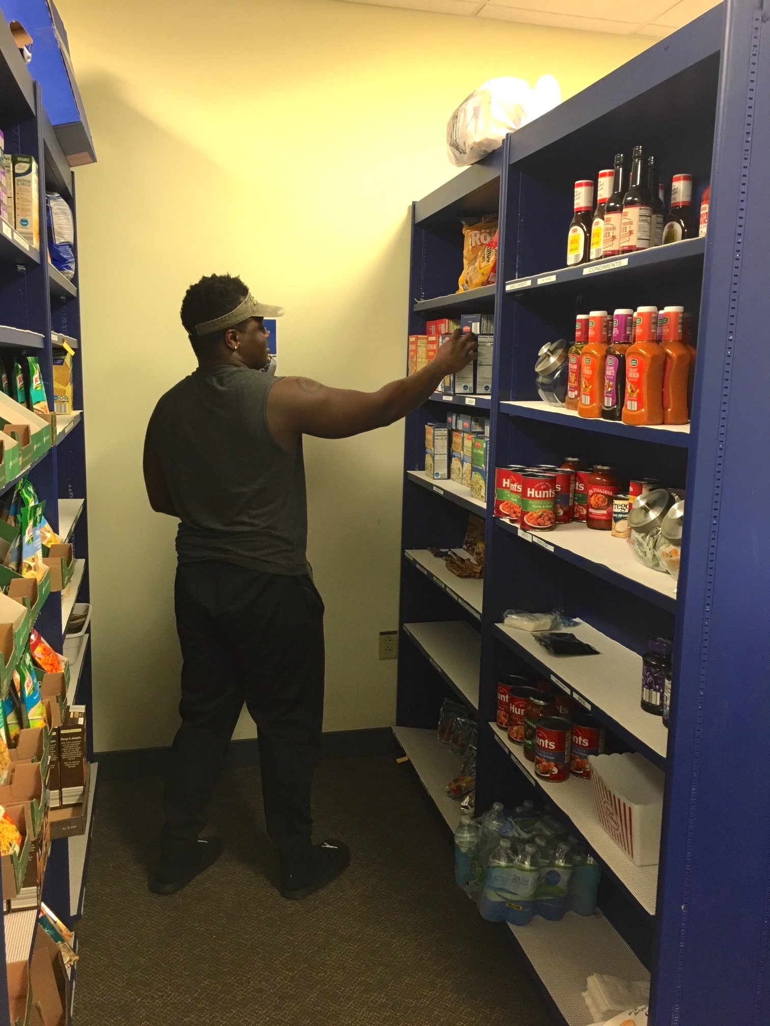 Student stocking shelves of food