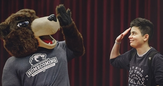 Bear Mascot giving high five to student