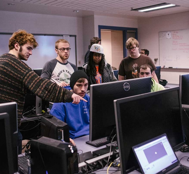 group of students looking at computers