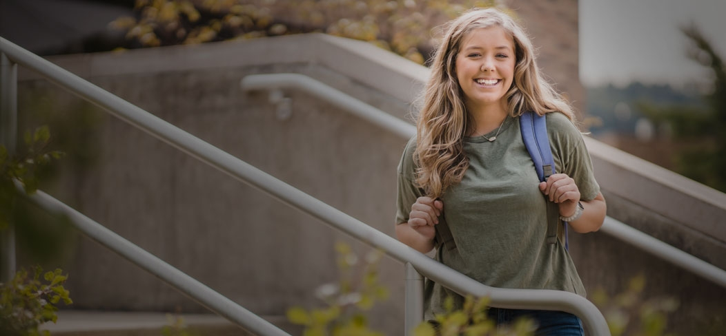 Female student smiling on campus